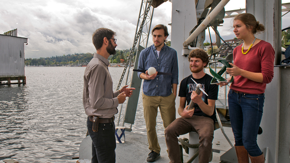 Lead researcher Andy Stewart with graduate students and the tidal prototypes. Image: Mary Levin/UW